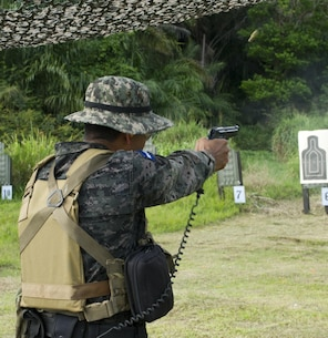 A Honduran Navy trainer demonstrates a basic live-fire drill for Honduran trainees April 5, 2016, along the northern coast of Honduras. The trainers are conducting the first ever consolidated course for basic infantry skills for the Honduran Navy, giving them a set of common skills to draw upon during counter-narcotic operations. (U.S. Air Force photo by Capt. Christopher Mesnard)