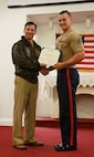 U.S. Navy Capt. Jay Steingold, left, presents U.S. Marine Corps Sgt. Zechariah Lund with a Navy and Marine Corps Achievement Medal May 3, 2016, at Naval Weapons Station Earle in Colts Neck, N.J. Lund received the award for training five sailors serving on the instillation's security force up to black belt in the Marine Corps' Martial Arts Program while strengthening the relationship between the Marines and sailors aboard the station. Steingold is the commanding officer for Naval Weapons Station Earle. Lund is the supply clerk for Recruiting Station New Jersey.