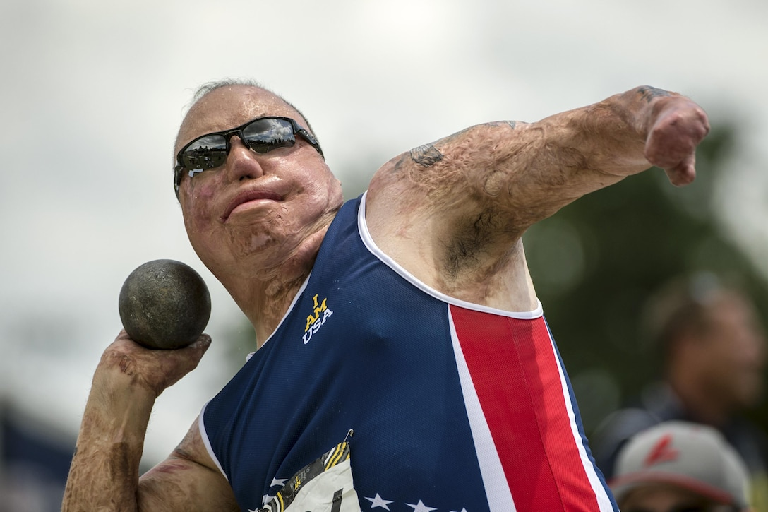 Air Force Master Sgt. Israel Del Toro throws a shot put during the 2016 Invictus Games in Orlando, Fla., May 10, 2016. DoD photo by EJ Hersom