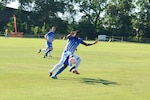 Air Force Midfielder Airman 1st Class Christopher Grant with the ball.  Grant scored two goals as Air Force defeated Marine Corps 5-0 in Match One of the Armed Forces Men's Soccer Championship at Fort Benning, Ga, 6-14 May 2016.
