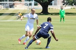 Army Sgt. Joseph Karslo (left) moves past Navy's Petty Officer 2nd Class Kyle Baker (#7).  Army defeated Navy 2-0 in Match Two of the Armed Forces Men's Soccer Championship at Fort Benning, Ga, 6-14 May 2016.