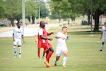 Marine Cpl. Adrian Brown (Left-Red) hits the go-ahead goal against Army to defeat them 1-0 in Match Four of the Armed Forces Men's Soccer Championship at Fort Benning, Ga, 6-14 May 2016.