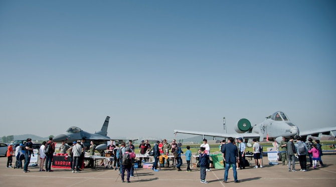 Attendees check out F-16 Fighting Falcon and A-10 Thunderbolt II static displays from Osan Air Base during the Gyeonggi Suwon Airshow 2016 at Suwon Air Base, Republic of Korea, May 7, 2016. Maintainers and pilots from the 51st Aircraft Maintenance Squadrons, 36th Fighter Squadron, 25th Fighter Squadron and 5th Reconnaissance Squadron took photos and answered questions during the airshow. (U.S. Air Force photo by Staff Sgt. Jonathan Steffen/Released)