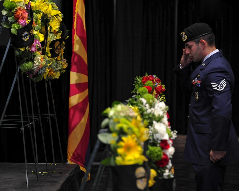 U.S. Air Force Staff Sgt. Raffi Stambultsyan, 355th Security Forces Squadron member, salutes a wreath during the 9th Annual Pima County Regional Law Enforcement Memorial at the Tucson Convention Center in Tucson, Ariz., May 6, 2016.  The memorial was held to honor local members of law enforcement who lost their lives while serving in the line of duty.  (U.S. Air Force photo by Senior Airman Chris Massey/Released)