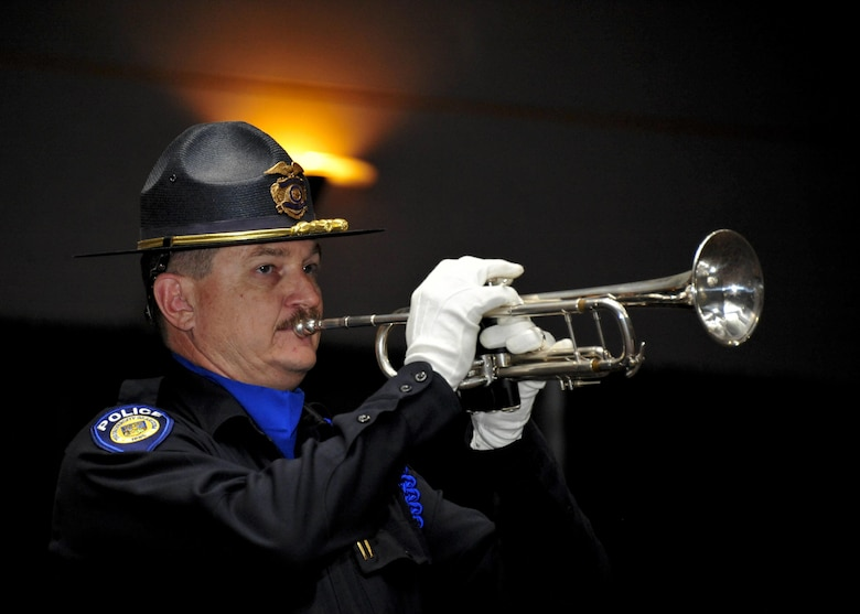 Detective John Dorer, University of Arizona Police Department officer, plays taps with a trumpet during the 9th Annual Pima County Regional Law Enforcement Memorial at the Tucson Convention Center in Tucson, Ariz., May 6, 2016.  The memorial was held to honor local members of law enforcement who have lost their lives while serving in the line of duty.  (U.S. Air Force photo by Senior Airman Chris Massey/Released)