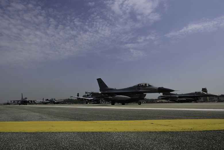 "A-10 Thunderbolt II and F-16 Fighting Falcon fighter aircraft perform an 'Elephant Walk' on the runway this week during Exercise Beverly Herd 16-01 at Osan Air Base, Republic of Korea. The Elephant Walk was a demonstration of U.S. Air Force capabilities and strength and showcases the wing's ability to generate combat airpower in an expedient manner in order to respond to simulated contingency operations. The A-10 Thunderbolt II aircraft are the 25th Fighter Squadron ""Draggins"" and the F-16 Fighting Falcon aircraft are the 36th Fighter Squadron ""Friends"" from the 51st Fighter Wing, Osan AB, ROK; the additional F-16 aircraft are the 179th Fighter Squadron ""Bulldogs"" from the 148th Fighter Wing out of Duluth Air National Guard Base, Minnesota. (U.S. Air Force photo by Senior Airman Dillian Bamman/Released)"