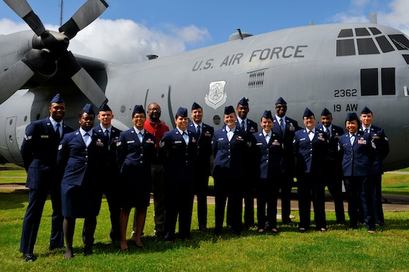 Service members from 19th Operations Group clenched Air Force Aviation Resource Management Annual Sergeant Dee Campbell Large Unit Award, May 2, 2016, at Little Rock Air Force Base, Ark.  The 19th OG certified 1,600 pre-mission checklists, delivered 30,000 passengers and 102,000 tons of cargo in support of command joint special operations air component allies. (U.S. Air Force photo by Airman Kevin E. Sommer Giron)