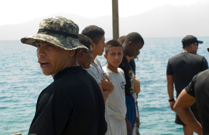 A Honduran Navy trainer calls for the next group of enlisted trainees during a swimming aptitude test April 4, 2016, on the northern coast of Honduras. The trainees took part in the first ever consolidated infantry training program in the Navy, giving them a common set of skills and knowledge to pull from in the future. (U.S. Air Force photo by Capt. Christopher Mesnard)