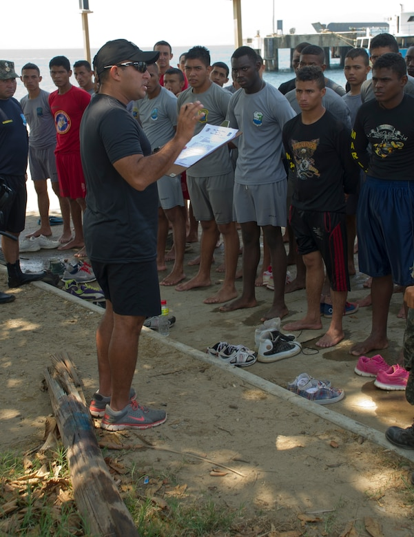 Honduran Navy Captain, Jose Gonzalez, provides feedback to a class of enlisted Honduran Naval trainees April 4, 2016, along the northern coast of Honduras. The trainees conducted a swimming aptitude test to establish their proficiency in the water and to better develop their skills as a group, during the first-ever consolidated infantry course hosted by the Honduran Navy. (U.S. Air Force photo by Capt. Christopher Mesnard/not released)