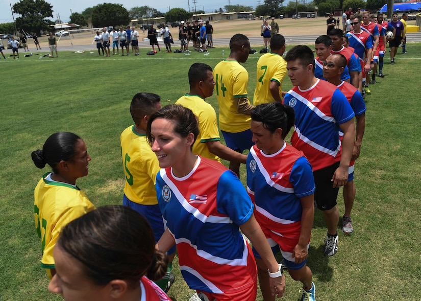 Members of the Joint Task Force-Bravo and Honduran Military Training Academy soccer teams shake hands following their match during the 2016 Camaraderie Day at Soto Cano Air Base, Honduras, May 5, 2016. The day was designed to celebrate the partnership between the armed forces of the U.S. and Honduras through friendly competition. (U.S. Air Force photo by Staff Sgt. Siuta B. Ika)