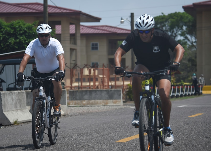 Members of the Joint Task Force-Bravo cycling team compete during the 2016 Camaraderie Day at Soto Cano Air Base, Honduras, May 5, 2016. The day of competition uses the international language of sports as a conduit to strengthen the bond between Honduran and U.S. service members. (U.S. Air Force photo by Staff Sgt. Siuta B. Ika)