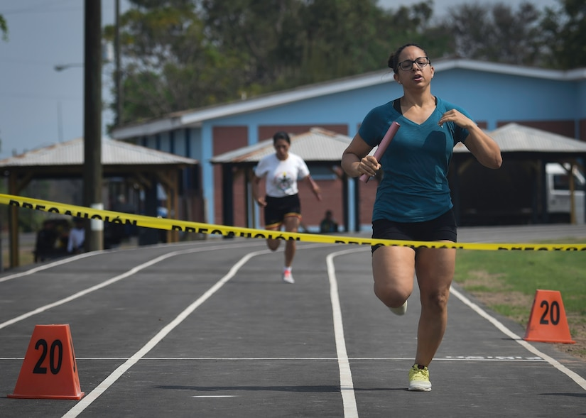 U.S. Air Force Capt. Amber El-Amin, anchor for the Joint Task Force-Bravo women's 4x200 meter relay team, prepares to cross the finish line ahead of the Honduran Military Training Academy's team during the 2016 Camaraderie Day at Soto Cano Air Base, Honduras, May 5, 2016. The U.S. team led by the second leg of the race and never gave up the lead from there. (U.S. Air Force photo by Staff Sgt. Siuta B. Ika)