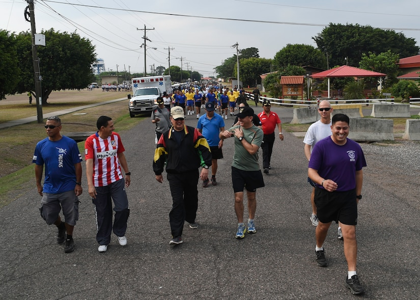 "Members of the Honduran and U.S. militaries kick off 2016 Camaraderie Day with a ""fun walk"" to warm up for the day's sporting events that included track and field, volleyball, a bike race and soccer, at Soto Cano Air Base, Honduras, May 5, 2016. The day was designed to celebrate the partnership between the armed forces of the U.S. and Honduras through friendly competition. (U.S. Air Force photo by Staff Sgt. Siuta B. Ika)"