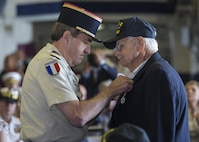 Capt. Jean-Michel Caffin of the French Army Reserve pins the Legion of Honor Medal onto an American World War II veteran aboard the USS Bataan during the Legion of Honor Ceremony in Fort Lauderdale, Fla., May 7, 2016. During the ceremony the Consulate General of France, Philippe Létrilliart, awarded nine American veterans with the Legion of Honor Medal for their heroic actions during the invasion of Normandy. The purpose of the event was to remember how important it is to pay tribute to the veterans who served so valiantly and also to highlight the long-standing friendship between the United States and France. (U.S. Marine Corps photo by Cpl. Michelle Reif/Released.)