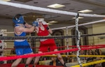 Air Force Staff Sgt. Ryan Savage, right, a 91st Security Forces Group evaluator, lands a punch during a boxing match in Minot, N.D., May 7, 2016. Savage is a state and regional champion and will compete for the national championship in the 152-pound weight class. Air Force photo by Airman 1st Class Christian Sullivan