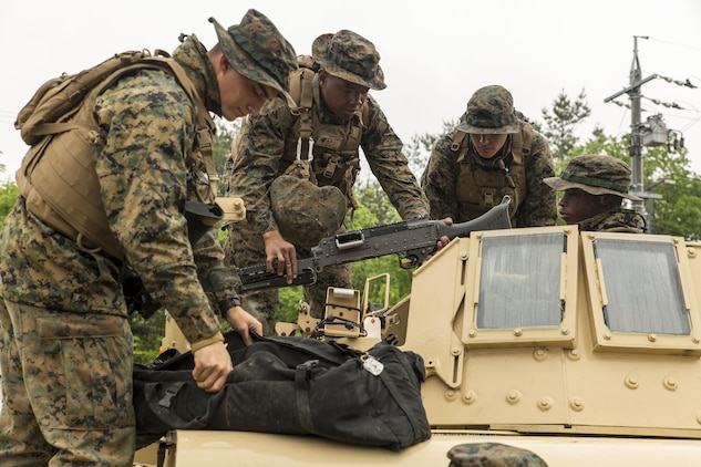 Marines with Marine Wing Support Squadron (MWSS) 171 assemble an M240 Bravo Light-Machine Gun on a high mobility multipurpose wheeled vehicle during exercise Thunder Horse 16.2 at the Japan Ground Self-Defense Force's Haramura Maneuver Area in Hiroshima, Japan, May 9, 2016. The squadron plans to conduct various drills pertaining to aviation ground support forces, aircraft salvage and recovery, convoys, direct refueling, recovery and general engineering operations, establishing a tactical motor pool, providing air operations and planning expeditionary fire rescue services. The exercise focuses on reinforcing skills that Marines learned during Marine Combat Training and throughout their military occupational specialty schooling in order to maintain situational readiness. (U.S. Marine Corps photo by Lance Cpl. Aaron Henson/Released)