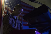 Airman 1st Class Sam Bachelder, a keyboard player with the U.S. Air Forces Central Command Band, Galaxy, plays during a performance at Hamid Karzai International Airport, Afghanistan, April 16, 2016. The band put on the performance for troops from more than 10 NATO member nations. (U.S. Army photo/Spc. Travis Terreo)