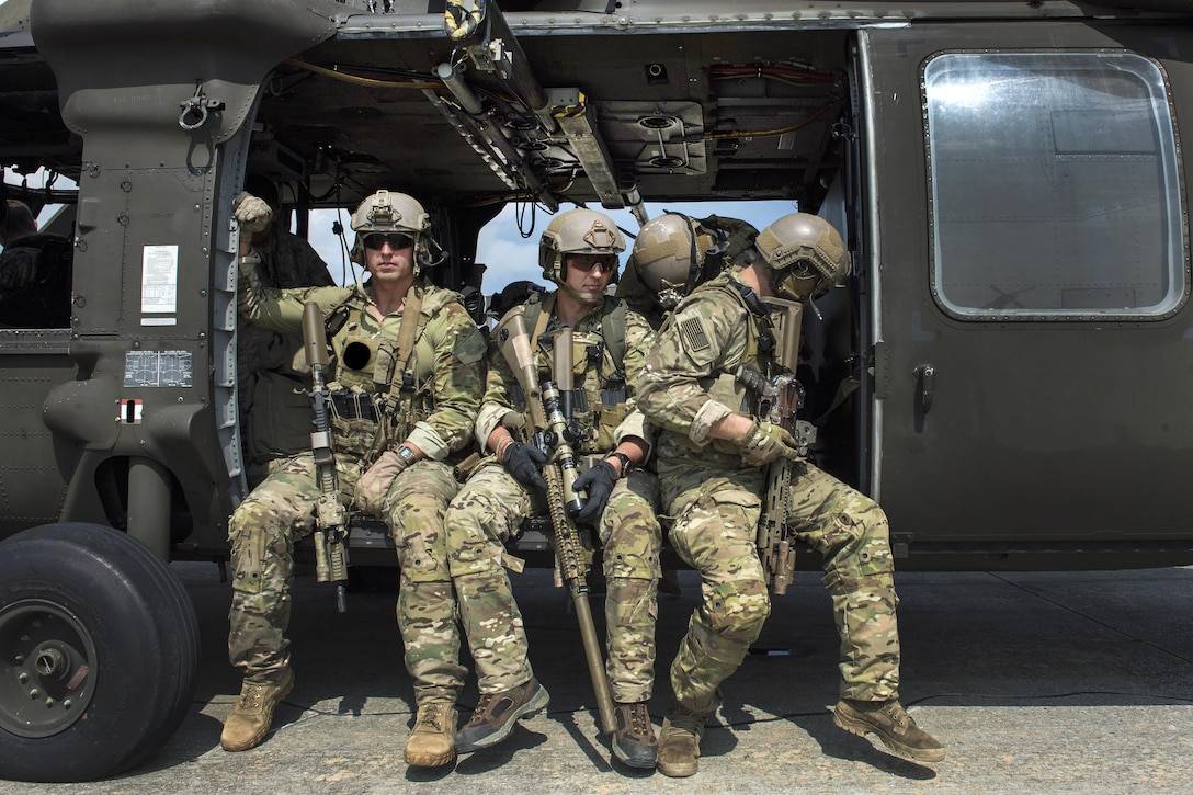 Army Special Forces snipers secure themselves in a UH-60 Black Hawk helicopter and wait for takeoff during Emerald Warrior 16 at Hurlburt Field, Fla., May 3, 2016. Air Force photo by Tech. Sgt. Gregory Brook