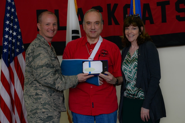Lt. Col. Todd Larsen, 5th Reconnaissance Squadron commander, presents a certificate of appreciation to Robert Boucher, Lockheed Martin mechanical engineer, during the 40th Anniversary U-2 Ceremony May 6, 2016, at Osan Air Base, Republic of Korea. Larsen thanked Boucher for his contributions to the 5th RS through supporting the U-2 Dragon Lady aircraft. (U.S. Air Force photo by Senior Airman Dillian Bamman/Released)