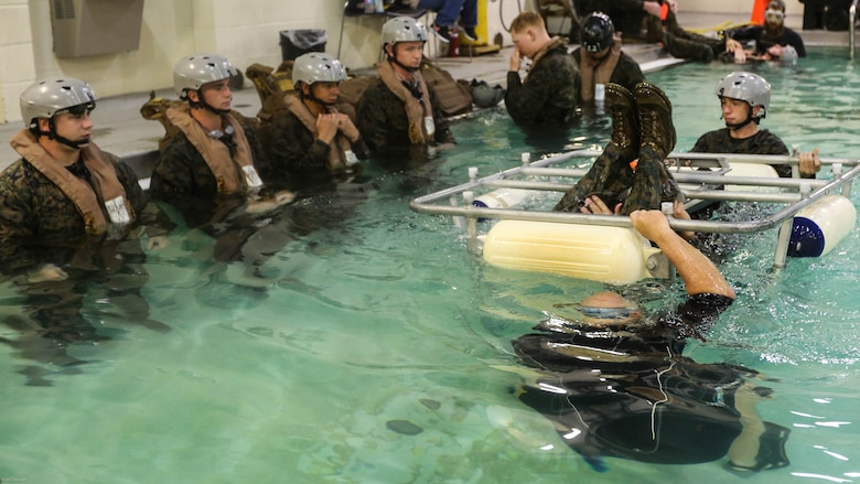 Marines with Marine Medium Tiltrotor Squadron 264 wait to escape the cage during water survival training at Marine Corps Base Camp Lejeune, Apr. 28, 2016. The Marines used a simulated helicopter body while training for different underwater escape scenarios as qualification to be attached to a Marine Expeditionary Unit.