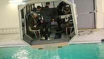 Marines with Marine Medium Tiltrotor Squadron 264 prepare to plunge into the water during survival training at Marine Corps Base Camp Lejeune, Apr. 28, 2016. The Marines used a simulated helicopter body while training for different underwater escape scenarios as qualification to be attached to a Marine Expeditionary Unit.