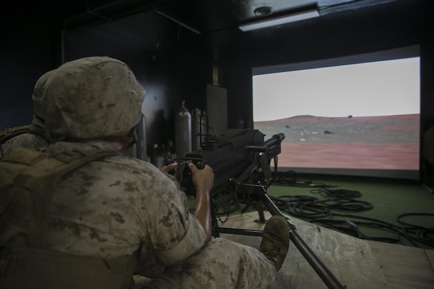 A Marine with Weapons Company, 2nd Battalion, 2nd Marine Regiment, fires on virtual targets with an Mk-19 automatic grenade launcher during training at the Indoor Simulated Marksmanship Trainer aboard Camp Lejeune, N.C., Aug. 5, 2015. The ISMT—used to train Marines on Mk 19s, M2 50-caliber machine guns, M240 medium machine guns and M16 service rifles—will be part of the Marine Corps Systems Command display at Sea Air Space May 16-18. (U.S. Marine Corps photo by Cpl. Sullivan Laramie)