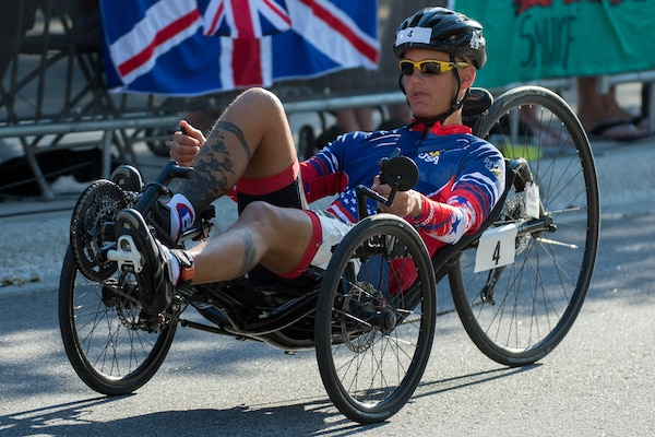 Army Sgt. Aaron Stewart races a recumbent bike