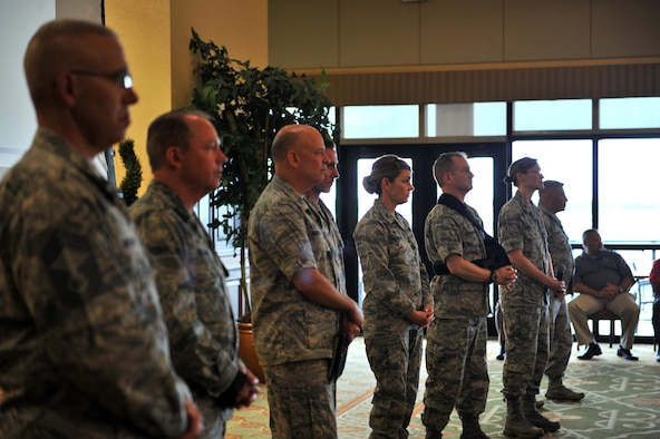 Keesler leadership listen to questions during a Q-and-A session of a town hall forum in the Bay Breeze Event Center ballroom, May 3, 2016, Keesler Air Force Base, Miss. Hosted by Col. Michele Edmondson, 81st Training Wing commander, the forum was used to discuss current base events, Keesler's dozens of recent command-level awards, emergency management, hospital and housing issues and the upcoming hurricane season. (U.S. Air Force photo by Senior Airman Duncan McElroy)