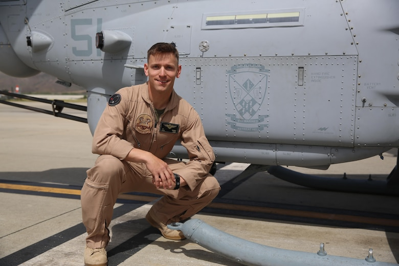 Capt. Jason Grimes, an AH-1Z Cobra pilot with Marine Light Attack Helicopter Squadron (HMLA) 369, poses next to the logo for 2nd Battalion, 5th Marine Regiment, painted on the side of a Cobra aboard Marine Corps Air Station Camp Pendleton, Calif., April 26. Squadrons with Marine Aircraft Group (MAG) 39 are partnered with ground units from 1st Marine Division to build stronger relationships as a part of MAG-39's new integration effort. (U.S. Marine Corps photo by Cpl. Alissa P. Schuning/Released)
