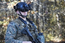 A student in the Marine Corps Infantry Officer Course uses the Augmented Immersive Team Trainer during testing held at Quantico, Va., Nov. 5, 2015. The AITT allows Marines to transform any location into a dynamic training ground by injecting virtual images, indirect fire effects, aircraft, vehicles, simulated people, etc. onto a real-world view of one's surroundings. AITT will be part of the Marine Corps Systems Command display at Sea Air Space May 16-18.  (U.S. Navy photo by John F. Williams)
