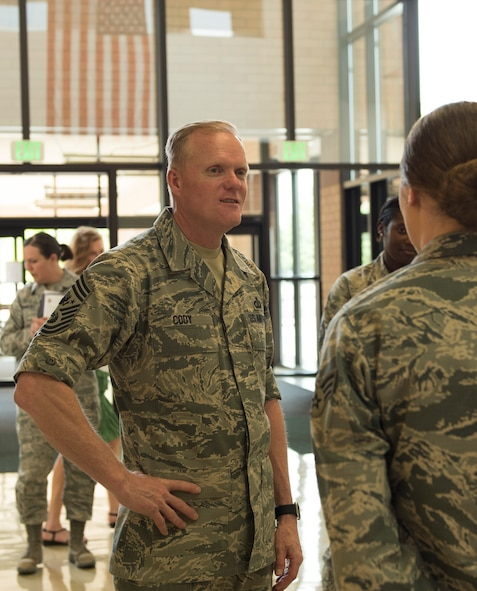 An airman from the 366th Medical Group briefs Chief Master Sgt. of the Air Force James Cody about the hospital, May 5, 2016, at Mountain Home Air Force Base, Idaho. The 366th MDG provides medical services to support approximately 24,000 eligible military beneficiaries. (U.S. Air Force photo by Airman Alaysia Berry/Released)