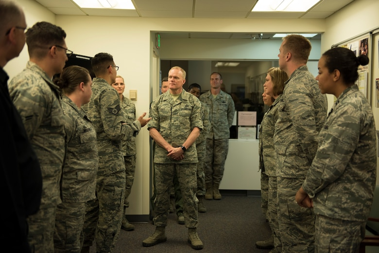 Staff Sgt. Landon Miracle, 366th Medical Operations Squadron mental health flight NCO in charge, briefs Chief Master Sgt. of the Air Force James Cody, May 5, 2016, at Mountain Home Air Force Base, Idaho. Cody discussed taking a more proactive approach to mental health to aid with the overall wellbeing of airmen. (U.S. Air Force photo by Airman Alaysia Berry/Released)