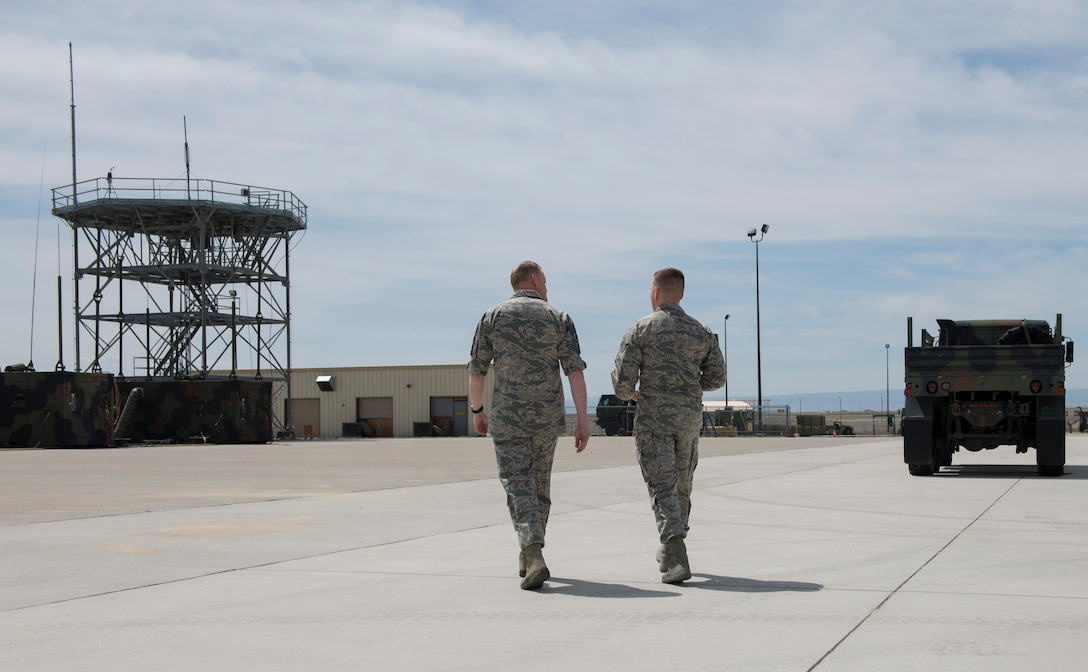 Chief Master Sgt. of the Air Force James Cody walks with an airman from the 726th Air Control Squadron during a visit May 5, 2016, at Mountain Home Air Force Base, Idaho. Cody interacted with airmen in various squadrons around base. (U.S. Air Force photo by Airman 1st Class Chester Mientkiewicz/Released)