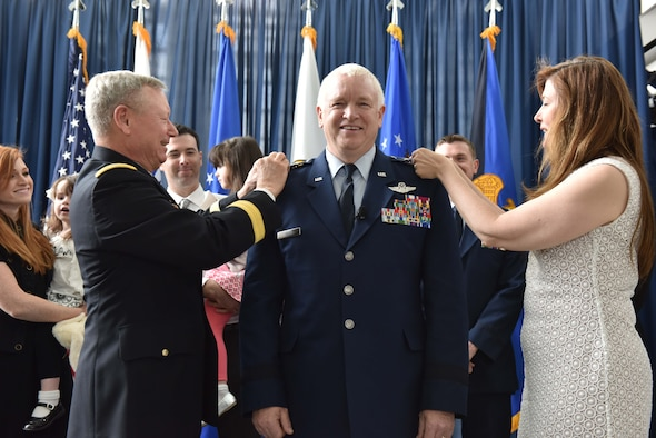 Air Force Lt. Gen. L. Scott Rice is pinned with his third star by his wife, and Chief of the National Guard Bureau Gen. Frank J. Grass during a promotion and assumption of responsibility ceremony at the Air National Guard Readiness Center on Joint Base Andrews May 10, 2016. Rice, who previously served as the adjutant general of the Massachusetts National Guard, became the 14th director of the ANG. (U.S. Army National Guard photo by Staff Sgt. Michelle Gonzalez/Released)