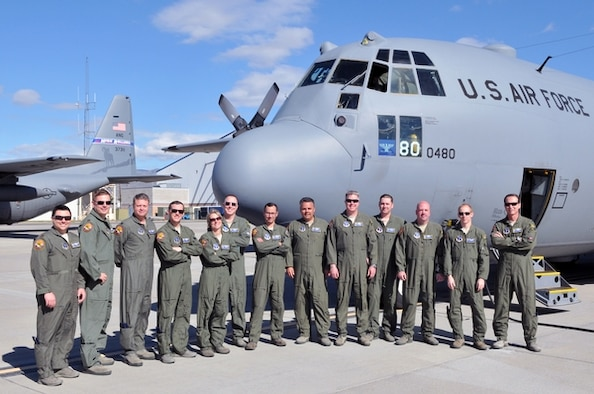 Members of the 152nd Airlift Wing, Nevada Air National Guard, pose for a photo on the flight line at the Nevada Air National Guard Base in Reno before their flight to Channel Islands Air National Guard Station, Calif., this week for the unit's first Modular Airborne Fire Fighting System certification and training. Maj. Ricardo Bravo, seventh from the left, saw firsthand last summer how MAFFS can stop a fire line when aircrews dropped retardant near his northern California farm. Photo by Tech. Sgt. Emerson Marcus