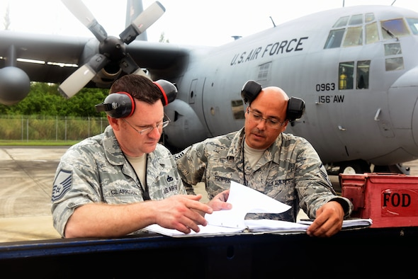 U.S. Air Force Master Sgt. Jeremy Clarkson, Air Mobility Command aircraft maintenance inspector, reviews a hurricane evacuation plan checklist with Master Sgt. Julio Fuentes, 156th Maintenance Squadron aircraft maintenance coordinator, during a category 5 hurricane exercise on Muñiz Air National Guard Base, Carolina, Puerto Rico, April 30. Members of the AMC Inspector General team completed a mid-point review visit to evaluate the 156th Wing Inspection Team. (U.S. Air National Guard photo by Tech. Sgt. Efraín Sánchez)