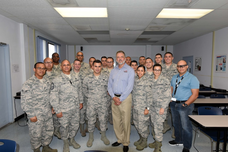 U.S. Air Force Senior Master Sgt. Orlando Soto Sanchez, 156th Airlift Wing human resource advisor, initiates the Puerto Rico Air National Guard First Four Development Course at Muñiz Air National Guard Base, Carolina, Puerto Rico, March 4. The First Four Development Course provided new PRANG airmen with guidelines and tools in the areas of finance, education and benefits that will establish a basic military knowledge foundation and help facilitate a successful military career. (U.S. Air National Guard photo by Staff Sgt. Pablo Pantoja)