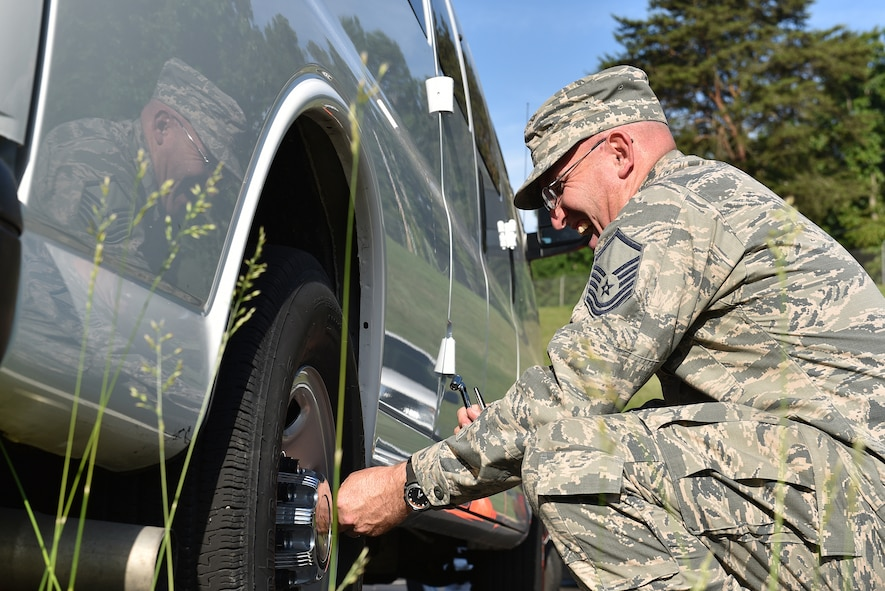 MCGHEE TYSON AIR NATIONAL GUARD BASE, Tenn. - Master Sgt. Don Pierson laughs as he checks the tire pressure on a government van here May 10, 2016, while managing his morning duties at the I.G. Brown Training and Education Center. Pierson is preparing for a reassignment after more than 10 years' service on campus. (U.S. Air National Guard photo by Master Sgt. Mike R. Smith/Released)