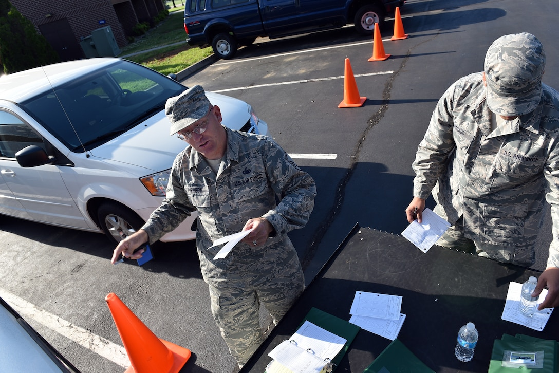 MCGHEE TYSON AIR NATIONAL GUARD BASE, Tenn. - Logistics Manager, Master Sgt. Don Pierson, left, and Master Sgt. Jose A. Santiago, Services manager, perform periodic maintenance on government vehicles here May 10, 2016, while managing morning duties at the I.G. Brown Training and Education Center. Pierson is preparing for reassignment after more than 10 years' service on campus. (U.S. Air National Guard photo by Master Sgt. Mike R. Smith/Released)