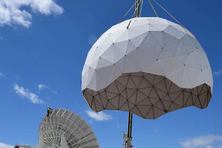 A crane removes the protective geodesic radar dome April 27, 2016, on Buckley Air Force Base, Colo. The 460th Communications Squadron and the 460th Civil Engineer Squadron are working with Radome Services LLC to replace the existing antenna with a new, more technologically advanced antenna that can better communicate with newer satellites. (U.S. Air Force photo by Airman 1st Class Luke W. Nowakowski/Released)