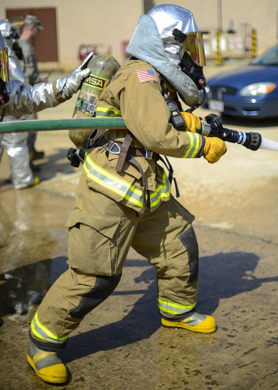 A 51st Civil Engineer Squadron firefighter operates a hose to extinguish a simulated vehicle fire during Exercise Beverly Herd 16-01 at Osan Air Base, Republic of Korea, May 12, 2016. Firefighters responded to the simulated fire after a mock improvised explosive device was detonated. (U.S. Air Force photo by Senior Airman Victor J. Caputo/Released)