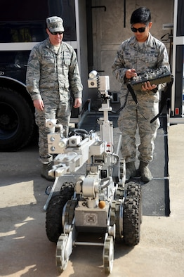 Staff Sgt. Timothy Ostberg and Staff Sgt. Paolo Pineda, 51st Civil Engineer Squadron explosive ordnance disposal technicians, operate an F6A EOD robot during a mock chemical improvised explosive device training at Osan Air Base, Republic of Korea, May 12, 2016. The training is part of Exercise Beverly Herd 16-01 and tests their abilities to respond and operate during combat operations. (U.S. Air Force photo by Staff Sgt. Jonathan Steffen/Released)