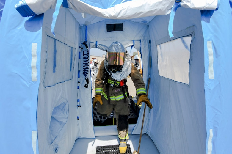 A firefighter from the 51st Civil Engineer Squadron enters the portable shower on a decontamination line after responding to a mock chemical improvised explosive device during Exercise Beverly Herd 16-01 at Osan Air Base, Republic of Korea, May 12, 2016. The decontamination line allows personnel leaving a hazardous area to be properly cleaned. (U.S. Air Force photo by Staff Sgt. Jonathan Steffen/Released)