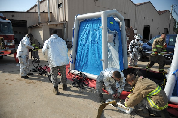Firefighters from the 51st Civil Engineer Squadron setup a decontamination line during Exercise Beverly Herd 16-01 at Osan Air Base, Republic of Korea, May 12, 2016. The firefighters tested their skills to respond to a mock chemical improvised explosive device. (U.S. Air Force photo by Staff Sgt. Jonathan Steffen/Released)