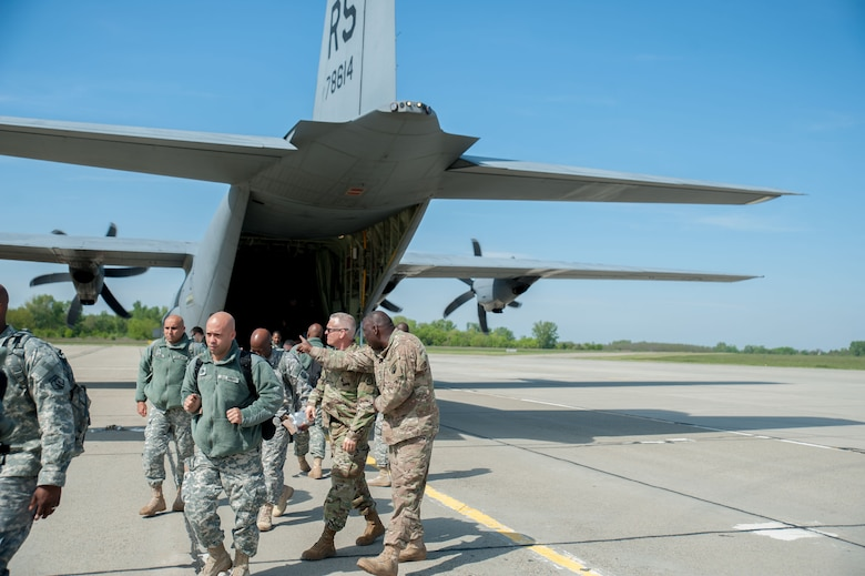 Soldiers from the 7th Mission Support Command exit a C-130 Friday, April 22, 2016 at Papa Air Base in Hungary to prepare for Exercise Anakdona Response 2016. For the roughly two-week long event, the U.S. organized a full assembly of military representation: Army, Navy, Marine Corps, Army Reserve, Army National Guard and Air National Guard. Also, the Hungarian military hosted the United Kingdom's Royal Army and Corps of Royal Marines.