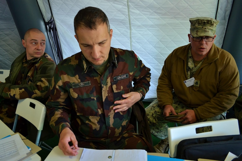 Hungarian Soldiers work with a U.S. Navy Sailor during Exercise Anakonda Response 2016, Sunday, May 1, 2016 at Papa Air Base in Hungary. For the roughly two-week long event, the U.S. organized a full assembly of military representation: Army, Navy, Marine Corps, Army Reserve, Army National Guard and Air National Guard. Also, the Hungarian military hosted the United Kingdom's Royal Army and Corps of Royal Marines.