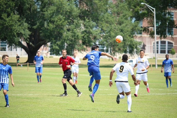1st Lt. Aaron Zendejas (blue #9) seen here heading the ball, scored the second goal of the match to give Air Force a 2-0 lead at halftime.  Air Force defeated Army 3-0 to win match six of the 2016 Armed Forces Men's Soccer Championship hosted at Fort Benning, Ga from 6-14 May 2016.  Navy advances to the Championship Match versus Air Force.