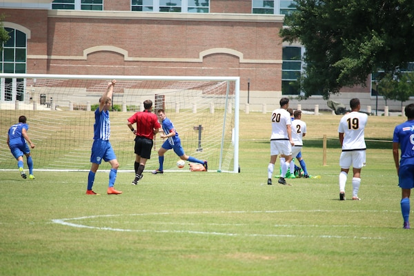 2nd lt. Taylor Moore (center in goal) boots in the first goal of the game lifting Air Force over Army for the 3-0 win in match six of the 2016 Armed Forces Men's Soccer Championship hosted at Fort Benning, Ga from 6-14 May 2016.  Air Force advances to the Championship Match versus Navy.