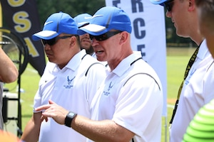 Air Force Head Coach Lt Col. Derrick Weyand (center) gives instructions during halftime as Air Force defeats Army 3-0 win in match six of the 2016 Armed Forces Men's Soccer Championship hosted at Fort Benning, Ga from 6-14 May 2016.  Air Force advances to the Championship Match versus Navy.