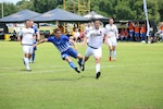 Air Force Senior Airman Jose Guillan (blue) shoots for the final goal of the game as Air Force defeats Army 3-0 win in match six of the 2016 Armed Forces Men's Soccer Championship hosted at Fort Benning, Ga from 6-14 May 2016.  Air Force advances to the Championship Match versus Navy.
